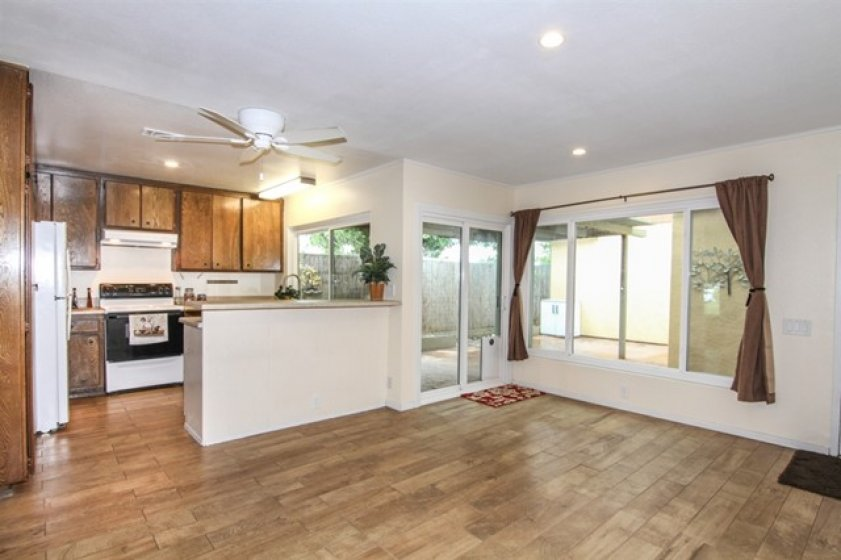 Kitchen nook looks out big window to private patio -