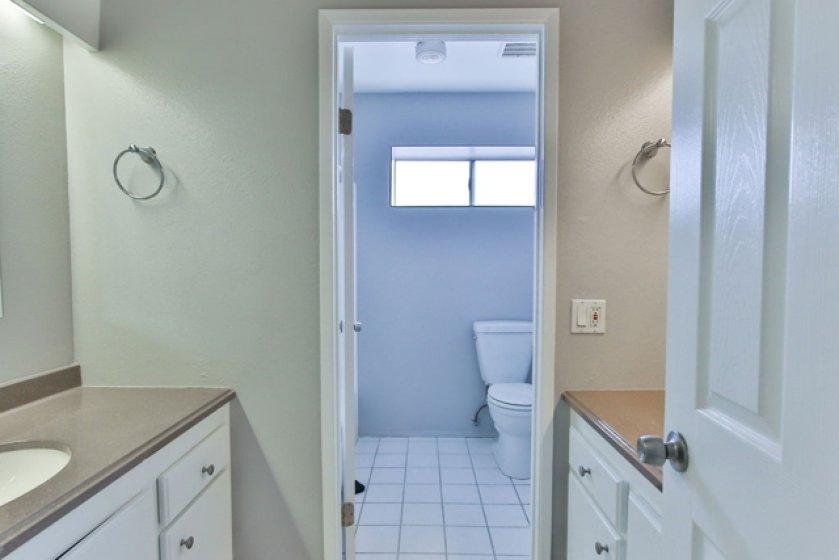 Upstairs bathroom with two vanities.