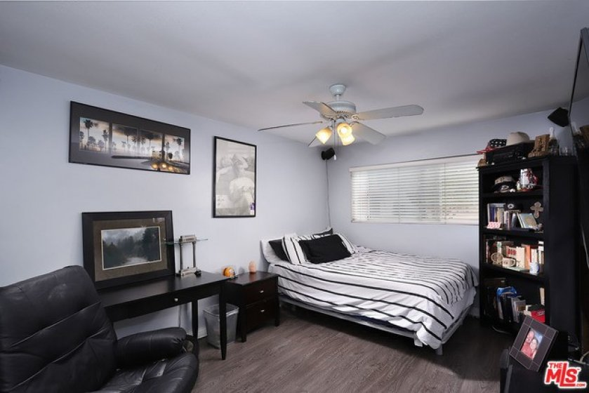 nd bedroom w/ ceiling fan and large closet space.