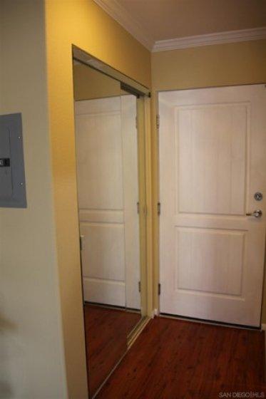 The entry has mirrored closet doors