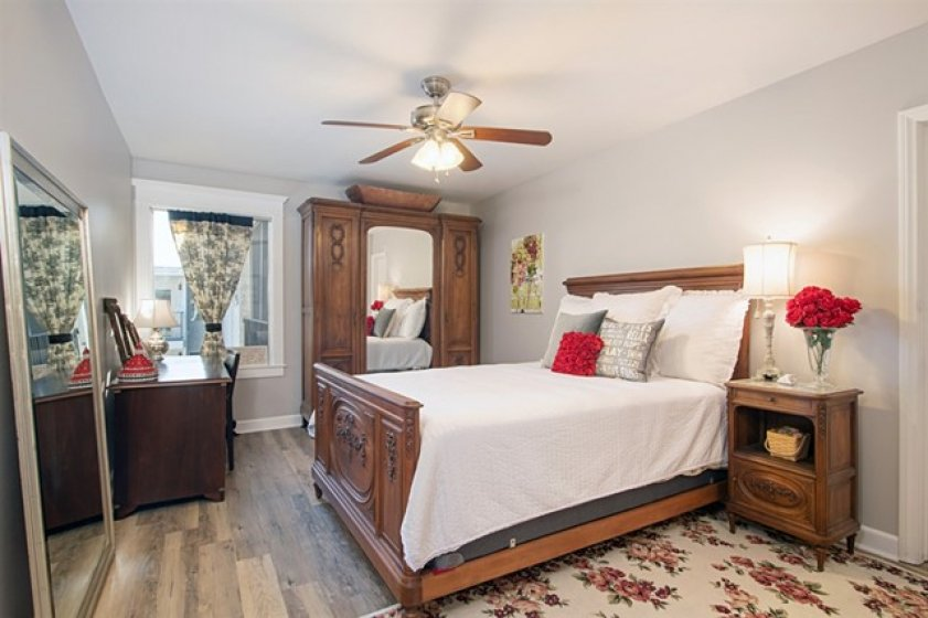 The beautiful floors are throughout all rooms. No carpet here!