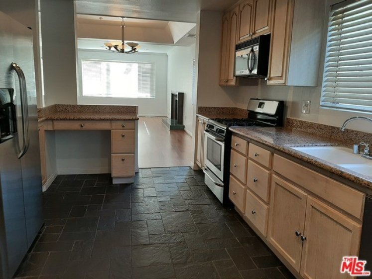 kitchen opens to dining area