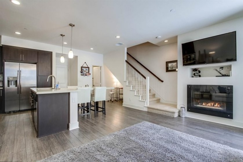 Gorgeous LR Electric Fireplace that changes colors in this Kitchen Family Room open floor plan.