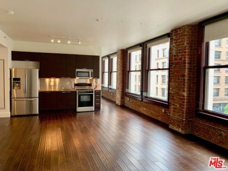 Hardwood floors and exposed brick