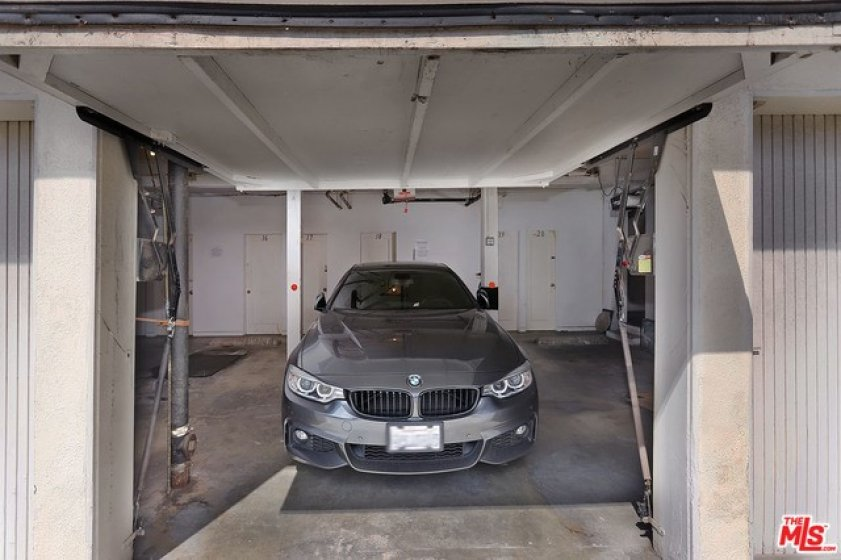 Large garage space wi additional storage room aigned to unit.