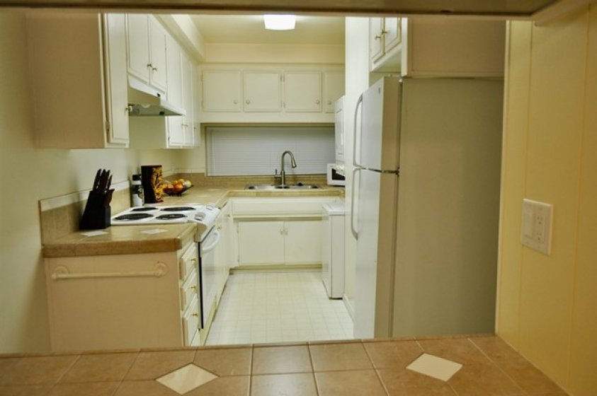 Ceramic tile counters, newer electric range/oven and laundry space