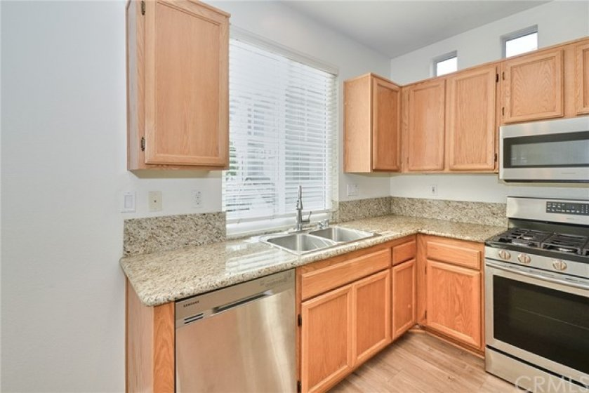 Kitchen  with Stainless Sink & Stainless Dishwasher   outside View & Brightness