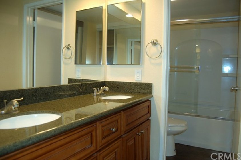 Master bathroom with dual sinks, tub and shower.