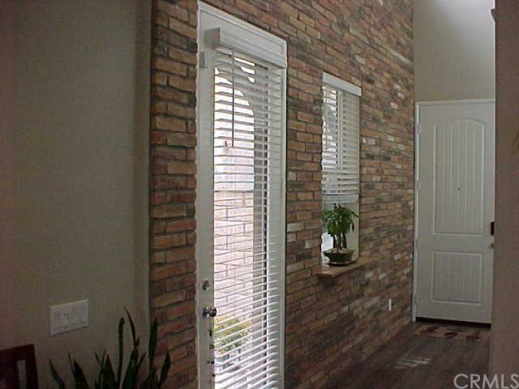 Brick Feature Wall in Entry and Side Yard Access Door