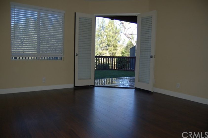 Master bedroom has French doors leading to back patio area.