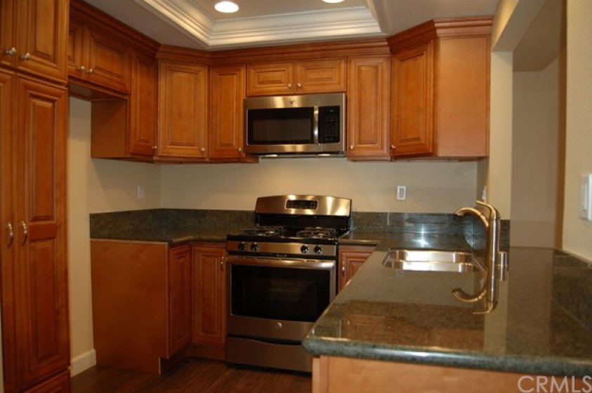 Remodeled kitchen with granite counter tops
