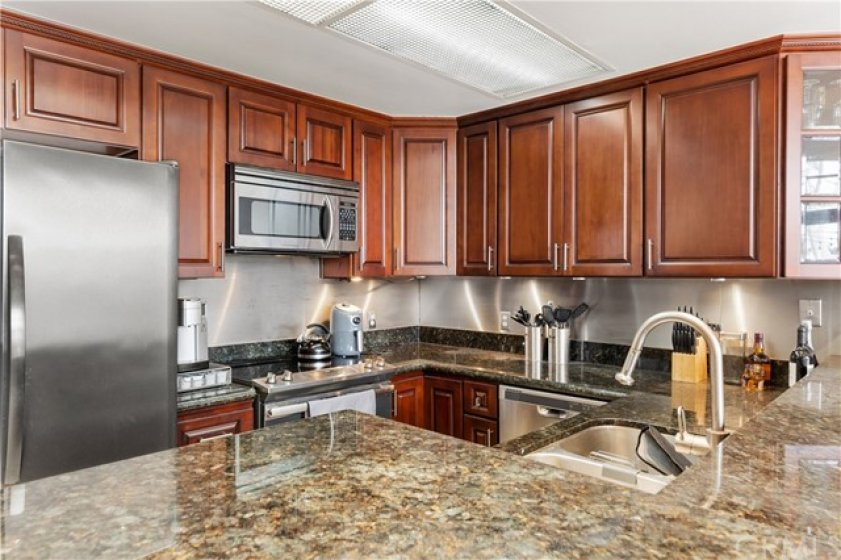 Galley kitchen remodeled with granite counter tops