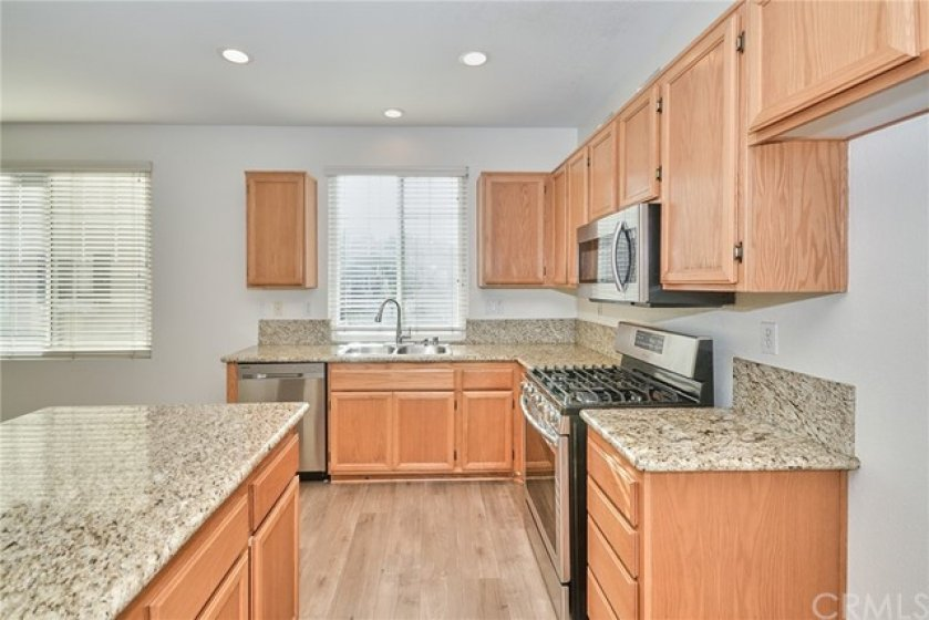 Kitchen with Newer Gas Cook Top with 5 burners, Micro-wave Oven & Built-in Oven