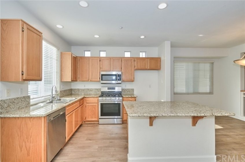 Kitchen cabinets,  and  Island  & Kitchen counter with Granite