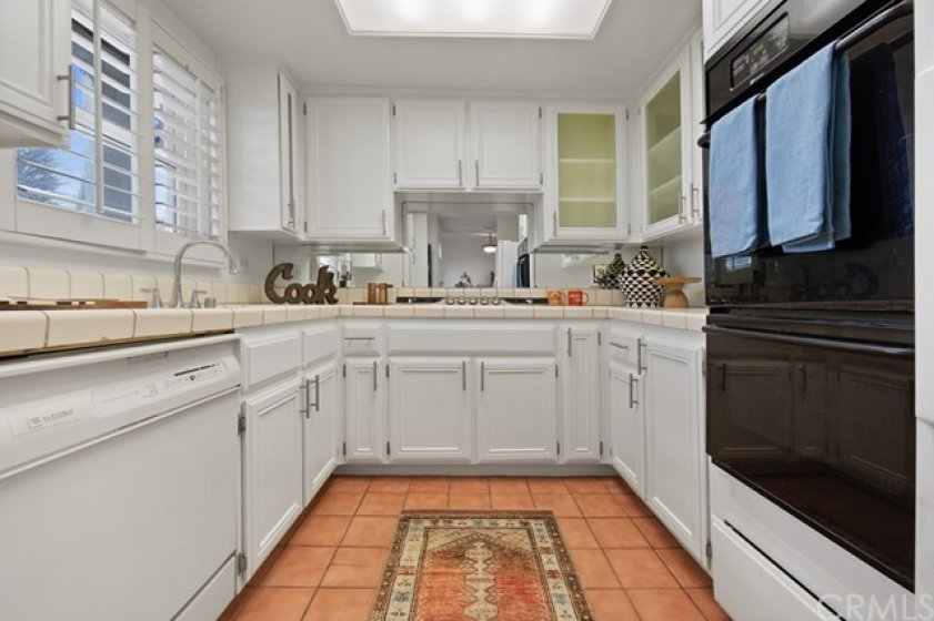 Kitchen view with gas cook top lots of storage cabinets
