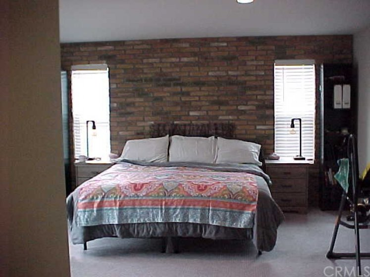Brick Wall Feature in Master Bedroom