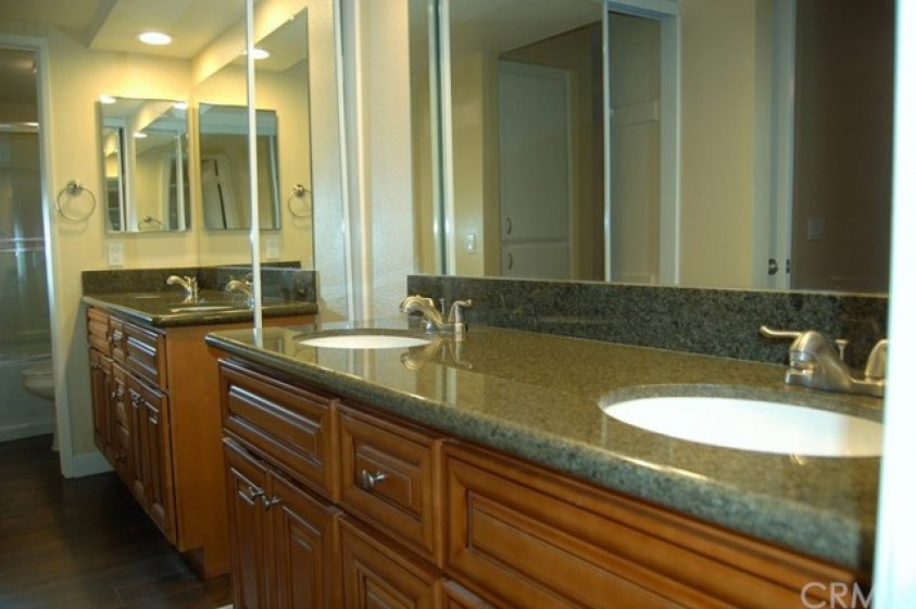 Another view of master bathroom with second mirrored wardrobe doors and recessed lighting.