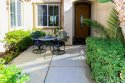 Enter into the gated courtyard and you are welcomed with beautiful landscaping & custom arched front door.