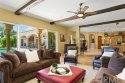 Exceptional family room open to the kitchen with fully opening doors to the beautiful back yard and pool area.