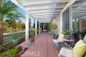 Covered alumawood patio runs the length of the patio