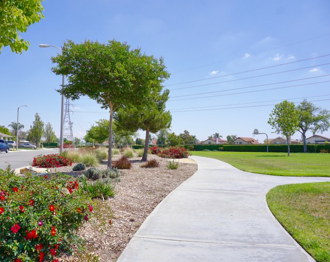 A sidewalk leads to a park near Archibald Ranch