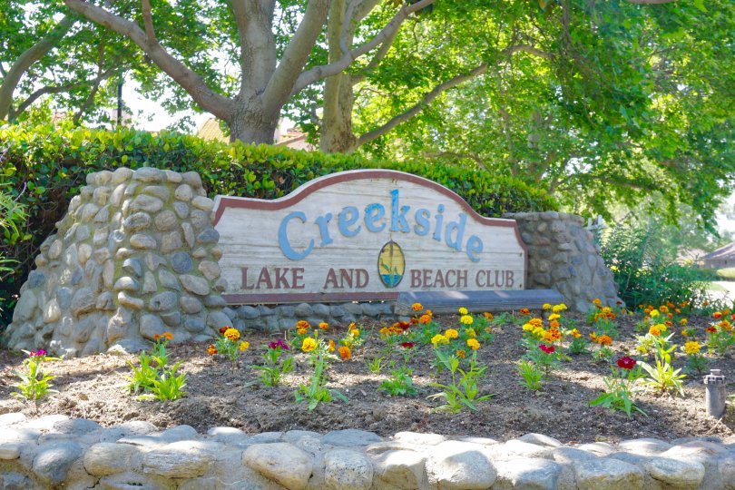 A stone and wood community marquee for Creekside