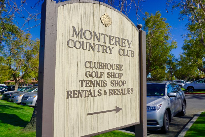 A Directional sign points to the Monterey Country Club Clubhouse