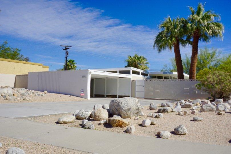 This El Rancho Vista Estates midcentury home is gated with a carport