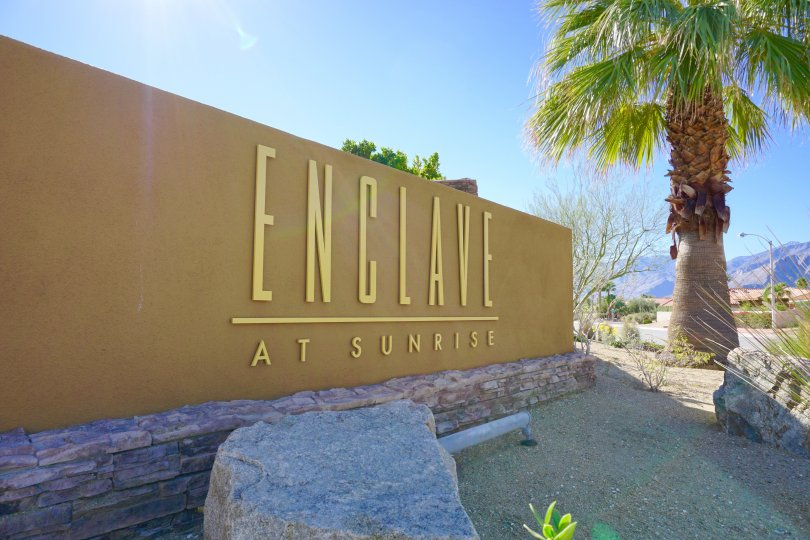 The Enclave at Sunrise Community Marquee with gold lettering