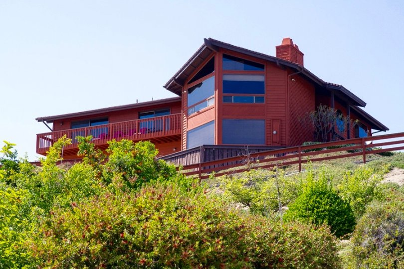 Stunning luxurious home with large windows offers direct natural light and phenomenal views of the landscape