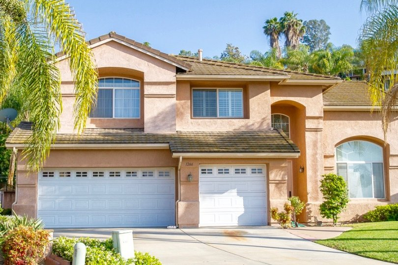 Beautiful Three car garage home with high ceiling rooms reside on a large spacious lot of Rancho El Cajon Neighborhood