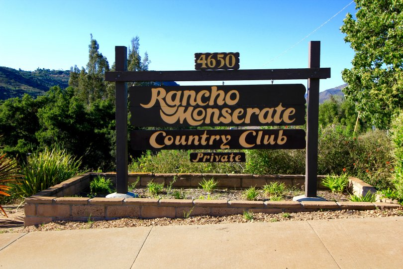 Rancho Moneserate Country Club sign at the entrance with stunning mountain range backdrop
