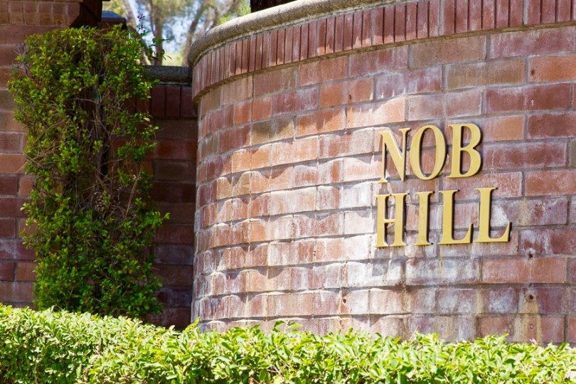 Nob Hill community Sign made of brick with gold lettering