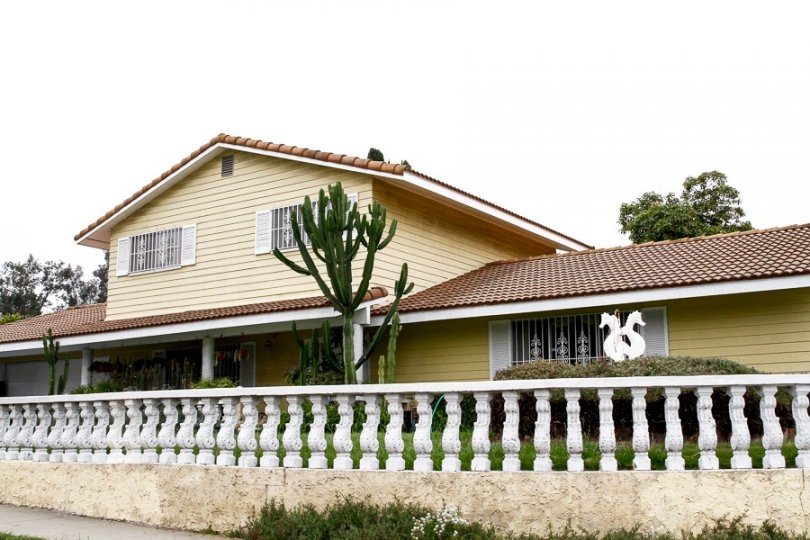 Two story home with beautiful white fence is located in Paradise Hills