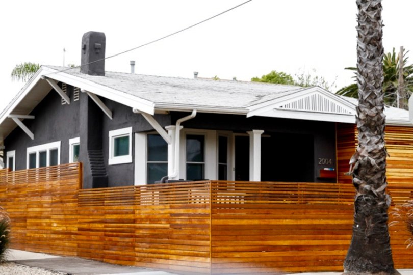 Gorgeous home with stunning wooden fences reside in University Heights