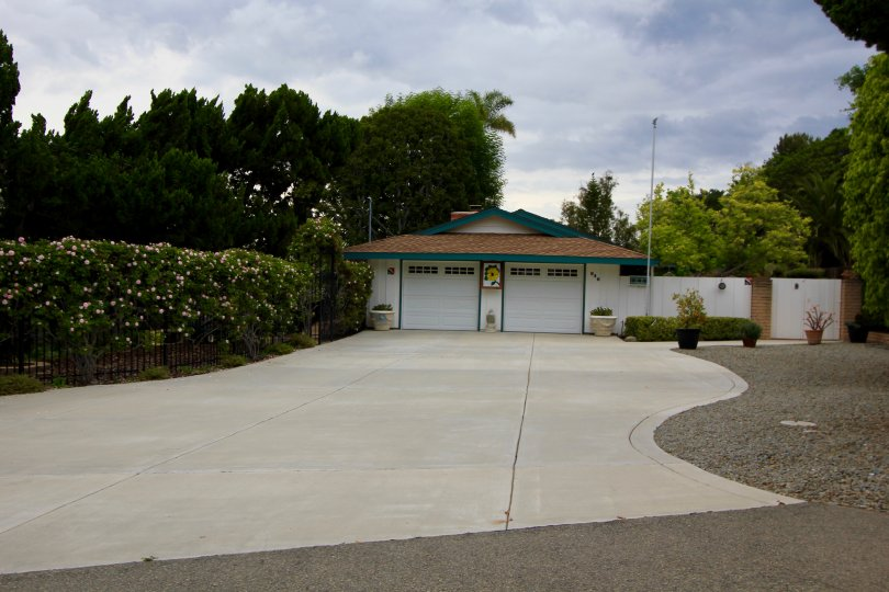 This Alta Vista home with two door garage and teal trim is part of Alta Vista Neighborhood