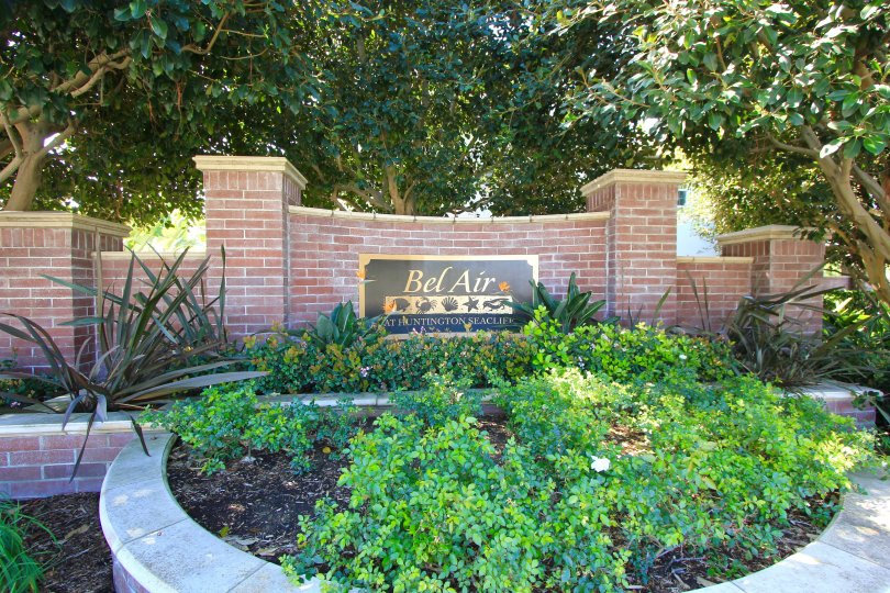 Bel Air community marquee on a curved brick Planter