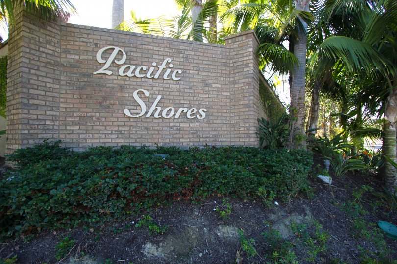 The Pacific Shores marquee is brick with white lettering