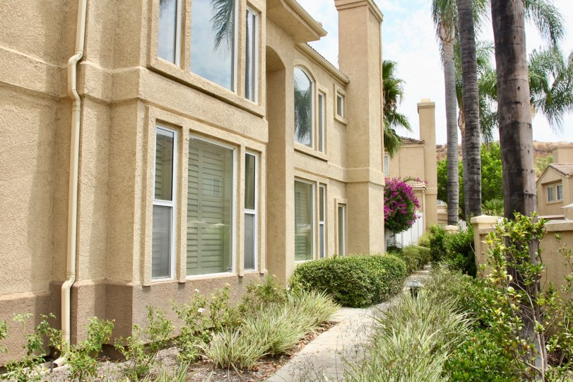 Beige apartments, a sunny day in the community of Altia, Corona CA with beautiful greenery