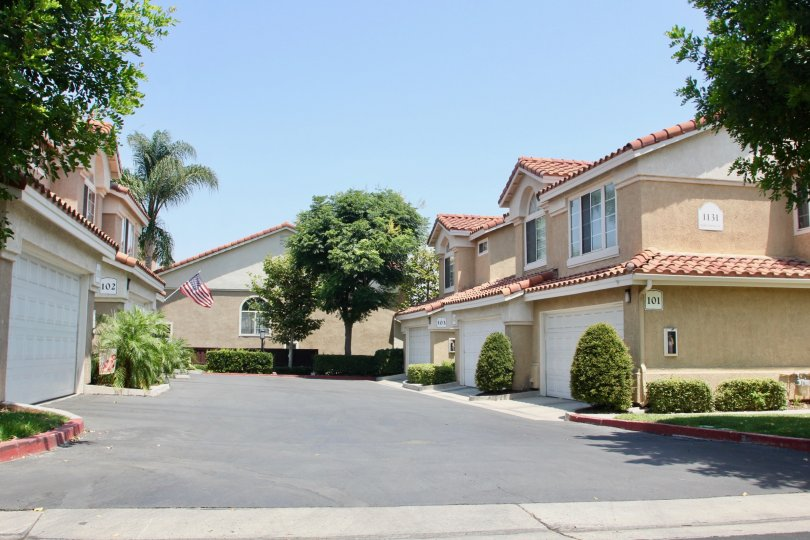 Beautiful sunny garages with nice manicured gardens at Cortina Community in Corona California