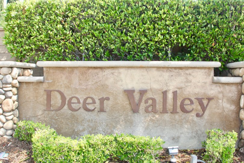 Deer Valley, A sky high beautiful constructed building with lots of greenery and flowers. A bright shiny sunny day enhance its look hundred times more.