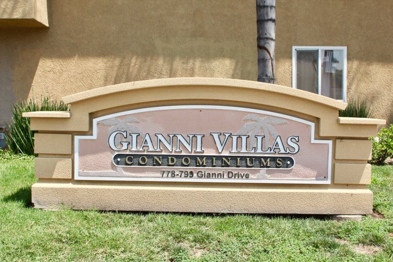 The sign with the address sits in front of the Gianni Villas.