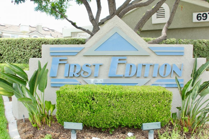 Sign of First Edition with the landscaping garden and trees