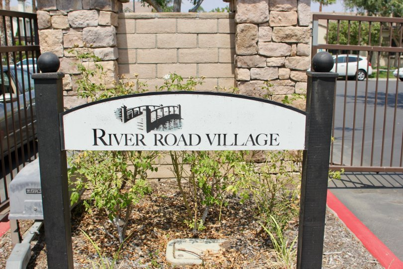 Gated entrance and sad garden at River Road Village