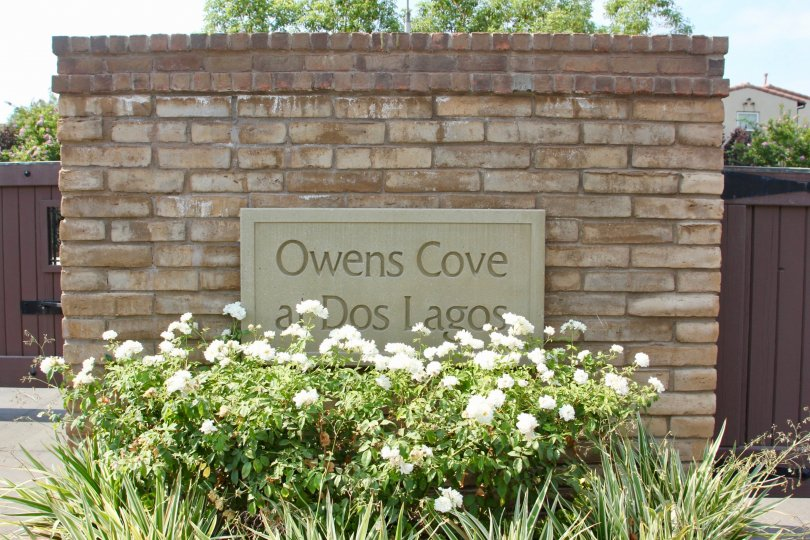"Sign reading ""Owens Cove at Dos Lagos"" at the Shady Grove community in Corona, CA"
