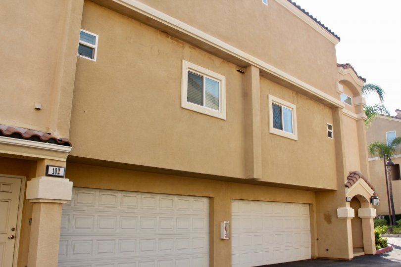 Garage doors of apartment building at The Village at Green River community in Corona, California