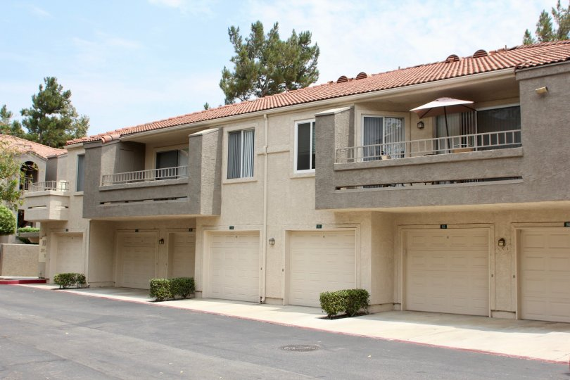 Single-family townhomes with attach garage and private balconies.