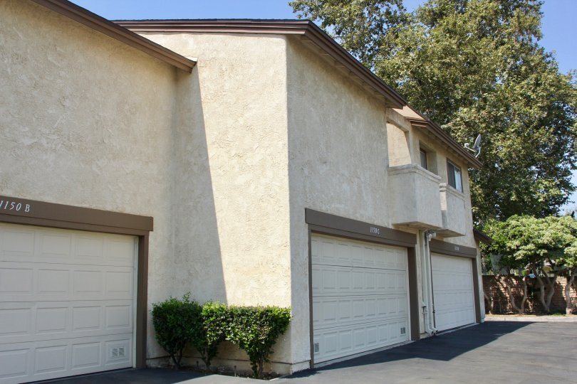 Brown trim surrounds a white garage on a building at Villa Montecito.