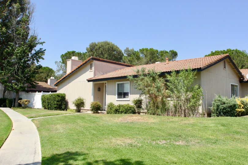 Village Grove Cluster and her cute bungalows with well mowed lawns, Corona, California