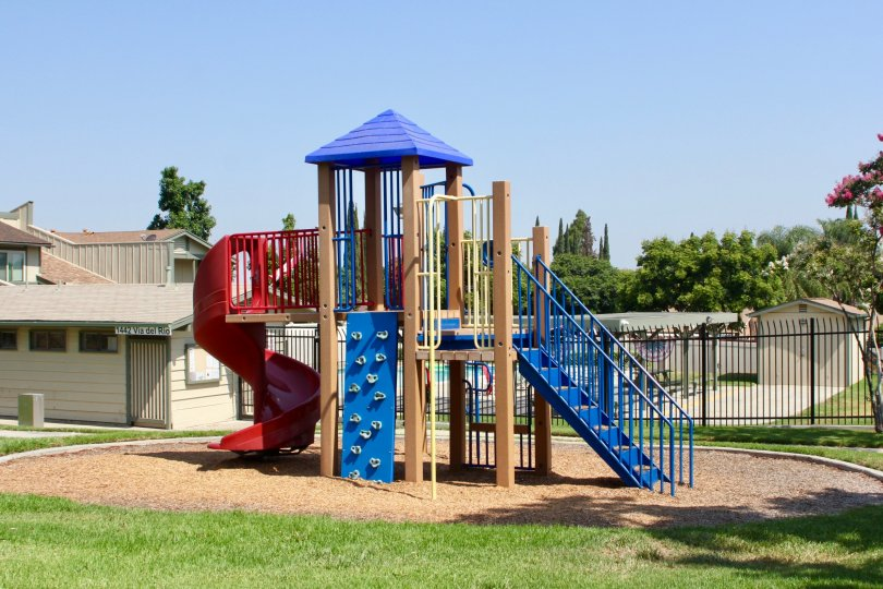small playing park is placed in front of house where childrens can play and get relaxed